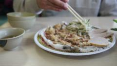 Vietnamese Banh cuon, with someone eating it Stock Footage
