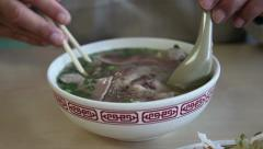 Vietnamese Pho bo, with someone eating it Stock Footage