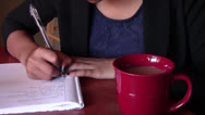 Stock Video Footage of Writing Financial Goals