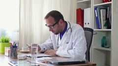 Doctor overwhelmed by too much paperwork HD Stock Footage