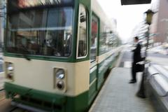 intentionally motion-blurred arriving train - stock photo