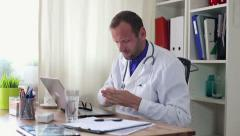 Male doctor taking pill for his headache HD Stock Footage