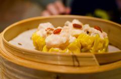 steamed dumplings with shrimp and pork , dim sum - stock photo
