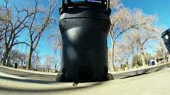 Dump Truck Gets two Garbage Cans - stock footage
