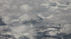 Flying  above snow mountains and clouds Stock Footage