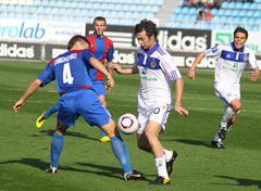 Artem Milevskyy of Dynamo Kyiv and Serhiy Symonenko of Arsenal - stock photo