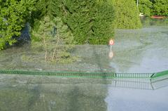 flooded green fence - stock photo