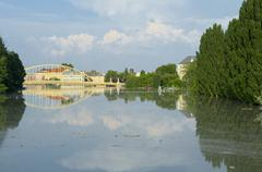 close-up view of flooded gyor town at sunset - stock photo