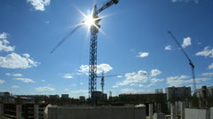 Construction crane against the blue sky Stock Footage