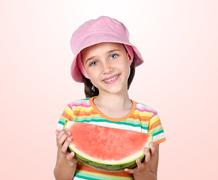 Stock Photo of adorable girl eating watermelon