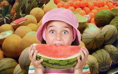 Adorable girl eating watermelon Stock Photos