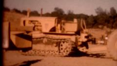 Old film 1950s construction site tracktors heavy equipment outdoors vintage life Stock Footage