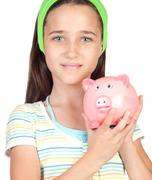 adorable little girl with money-box - stock photo