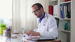 Male doctor write rx prescription HD - stock footage