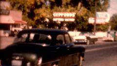Old film cars traveling 1950s small town lifestyle vintage outdoors lifestyle Stock Footage