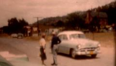 Old film 1950s Copper people talking as cars travel street road vintage outdoors Stock Footage