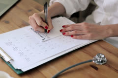 Female doctor writing rx prescription NTSC Stock Footage