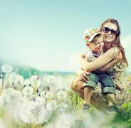 Attractive woman playing with her son Stock Photos