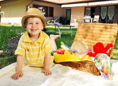 little kid and the basket full of toys - stock photo