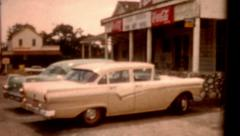 8mm film Copper Inn Cafe 1950s cars and people in parking lot vintage Stock Footage