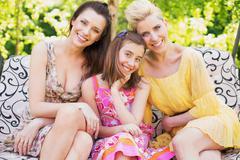three happy women smiling to the camera - stock photo