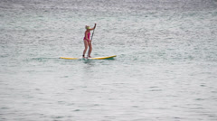 Woman Stand up Paddleboarding Stock Footage