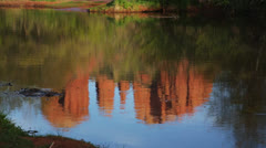 Cathedral Rock reflecting in Oak Creek, Sedona, Arizona (tilt) Stock Footage