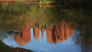 Cathedral Rock reflecting in Oak Creek, Sedona, Arizona (tilt) Stock Footage