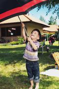 Stock Photo of young boy with big umbrella
