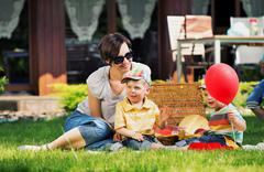 photo presenting happy family in the garden - stock photo