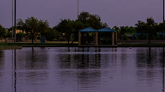 HD 30p tight v2 - Chandler Desert Breeze Park lake - dusk transition time lapse Stock Footage