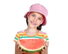 adorable little girl with a big piece of watermelon - stock photo