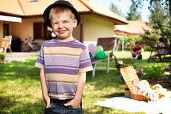 Cute liitle boy wiearing small hat Stock Photos