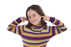 pretty girl covering her ears - stock photo