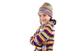 Stock Photo of adorable little girl with clothes for the winter