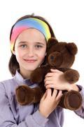 pretty girl with teddy bear - stock photo