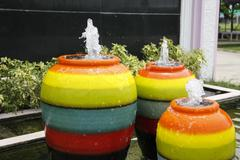 colorful jar fountain - stock photo
