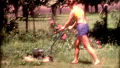 1950s old film young female mowing lawn retro yellow attractive vintage fashion Stock Footage