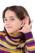 Adorable girl hearing Stock Photos