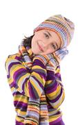 adorable little girl with clothes for the winter - stock photo