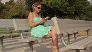 Stock Video Footage of Woman Sits on Bench