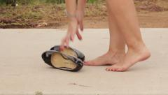 Woman Cute Feet Removes Black Heels and Carries Them Stock Footage
