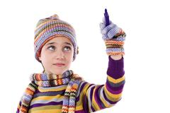 adorable little girl with clothes for the winter writing - stock photo