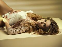 Alluring young woman lying down on the floor Stock Photos