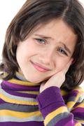 Adorable girl whit toothache Stock Photos