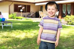 happy little boy laughing to the camera - stock photo