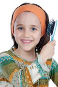 Girl brushing her hair Stock Photos