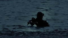Navy Seals Diver in the night, moonlight reflection on the water Stock Footage