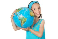 girl with a globe of the world - stock photo