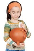 girl putting its savings - stock photo